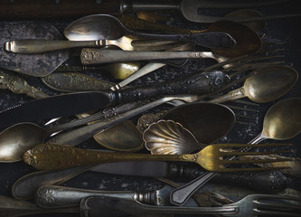 Old spoons, forks and knives, vintage style.
