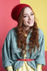 fashionable smiling hipster girl in hat