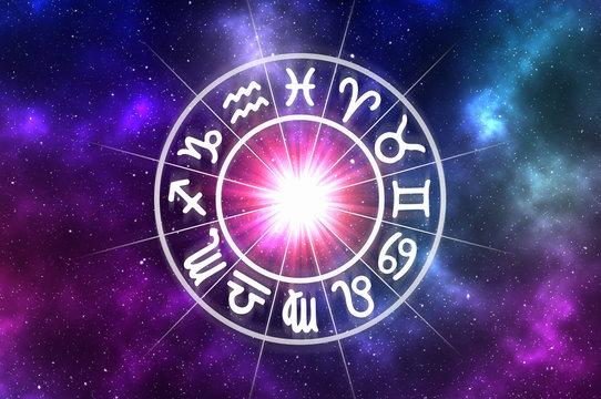 Zodiac signs inside of horoscope circle on universe background