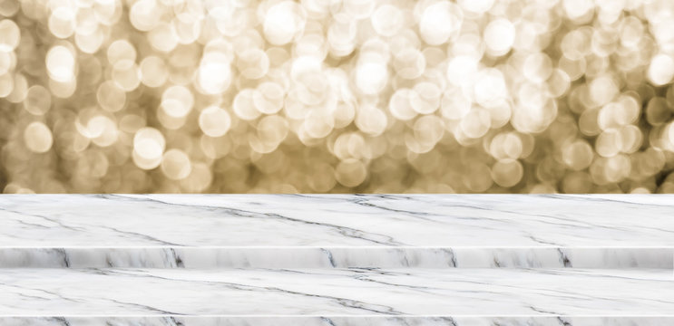 Empty marble step table stand with blur abstract sparkle gold background bokeh light,Mock up for display or montage of product,Banner or header for advertise on online media,Holiday celebrate concept.
