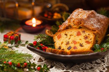 Christmas fruitcake. Natural wooden background.