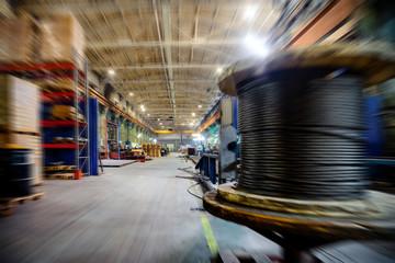 Large industrial shop, motion blur effect.