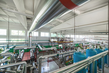 Modern boiler room. Complex system of tanks, pipelines, pumps and valves.