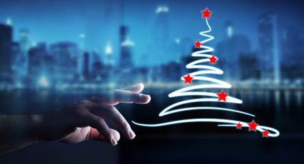 Businessman holding and touching christmas trees sketch