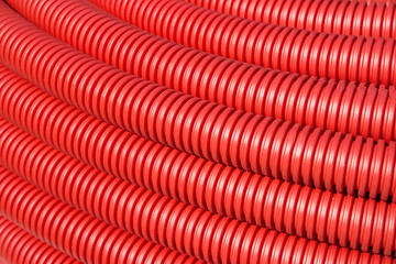 roll of red Flexible Plastic Pipes
