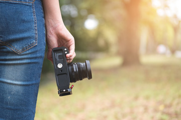 Photographer, Camera on female hand. Photograph hobby
