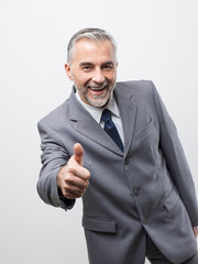 Confident business executive giving a thumbs up