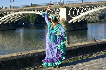 The woman dancing flamenco at river bank