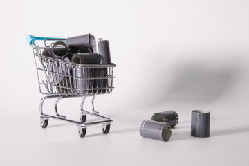 Shopping trolley and tangle of unrolled exposed 35mm film strips