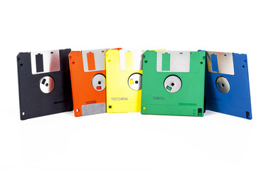 floppy in five colors. Flopy floppy floppys flopys. Old computer data technology. Disc. Flopy disc. Floppy disc. Flopy discs. Floppy discs. Colorful Floppy disc. Flopy disc in orange an green. Photo