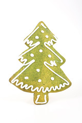 Christmas tree shaped gingerbread with dye green paint and sugar decoration. Photo.
