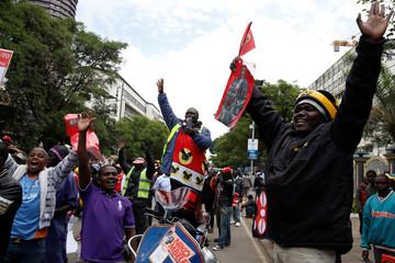 Jubilee Party supporters cheer after Kenya's Supreme Court upheld the re-election of President Uhuru Kenyatta in last month's repeat presidential vote, in Nairobi