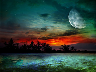 The ocean, sunset and moon