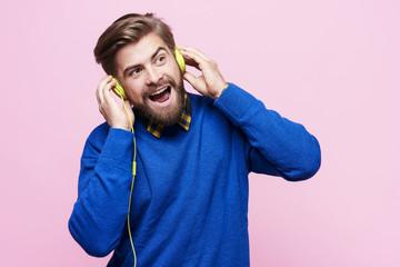 Man with headphones singing
