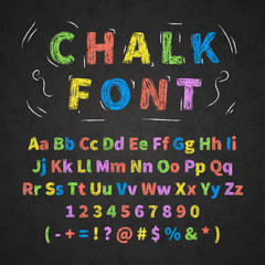 Colorful retro hand drawn alphabet letters drawing with chalk on black chalkboard