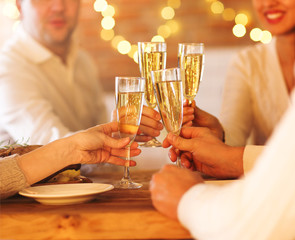Champagne glasses in people hands