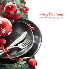 Christmas menu concept with black plates and cutlery isolated on white, space