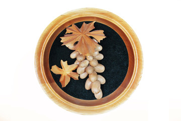 Grapes from the tree. Handmade. Wooden grapes in a frame on a white background