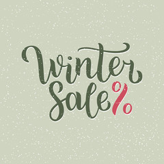 Winter sale hand written inscription with isolated on blurred abstract background with snowflakes. Vector illustration. Lettering. Postcard for winter season advertising.