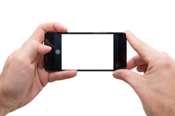 male person horizontally holding a smartphone with both hands ready to take a picture isolated on white