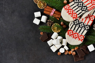 Ingredients for hot chocolate on a black background. Warm winter drink. Happy New Year and Merry Christmas.