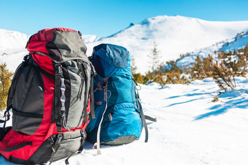 Two backpacks on the snow.