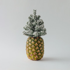 Pineapple and winter Christmas tree. Holiday concept.