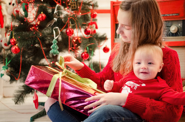 Teen sister with her baby brother in Christmas time
