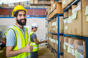 Warehouse worker checking stock products