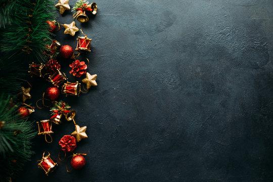 festive christmas toys on dark background. atmosphere of winter holidays.
