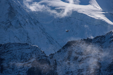 Rescue helicopter fly in Swiss Alps