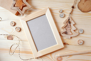 Wooden frame Christmas mockup, stock photography. Design works presentations, for bloggers and social media. Flat lay, top view photo mockup