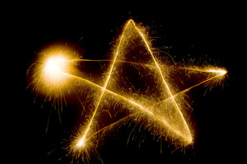 star written in the spark on a dark background