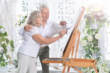 Senior couple drawing picture
