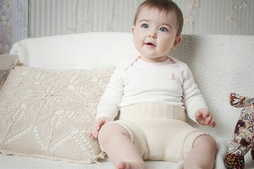 A small child in natural tissue diapers, eco-friendly cotton diapers