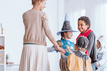 Children in costumes dancing