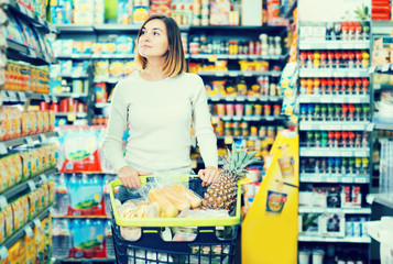 Woman doing shopping with shopping cart