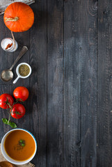 Homemade Pumpkin Soup on rustic wooden background, free space for text.