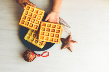 Homemade fresh golden waffles delicious breakfast. Top side close up view refreshment healthy seasonal diet texture background concept
