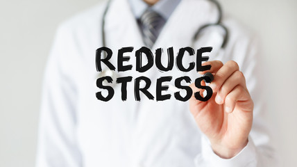 Doctor writing word Reduce Stress with marker, Medical concept