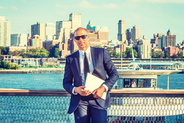 European Businessman with shaved head travels, works in New York