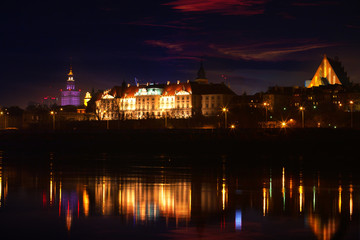 Panorama of Warsaw at night - a view over the Vistula River at the Royal Castle