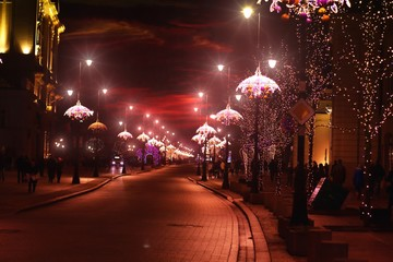 Panorama of Warsaw at night - view of Nowy Swiat street in Christmas decorations
