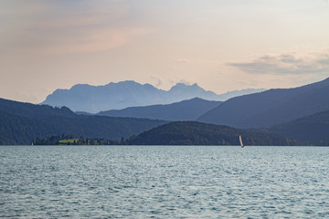 Sailing on Walchensee in Bavaria, Germany with beautiful view towards Zugspitze at dusk