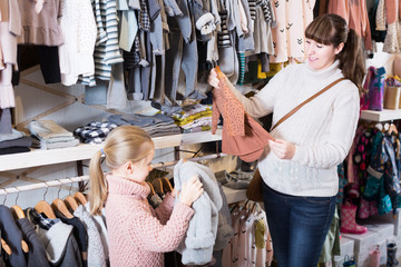Woman with  daughter considered range of  clothes