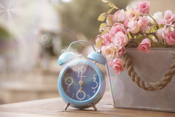 Blue clock with Artificial Flowers