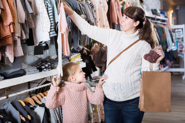 Mother and daughter choosing children's clothes