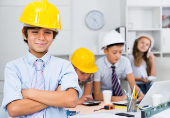 Teenager boy engineer and children with plan