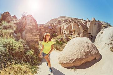 Tourist traveler in Zelve cave town in Cappadocia