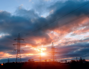 Silhouette image of the high voltage electricity pole with sky on sunset time